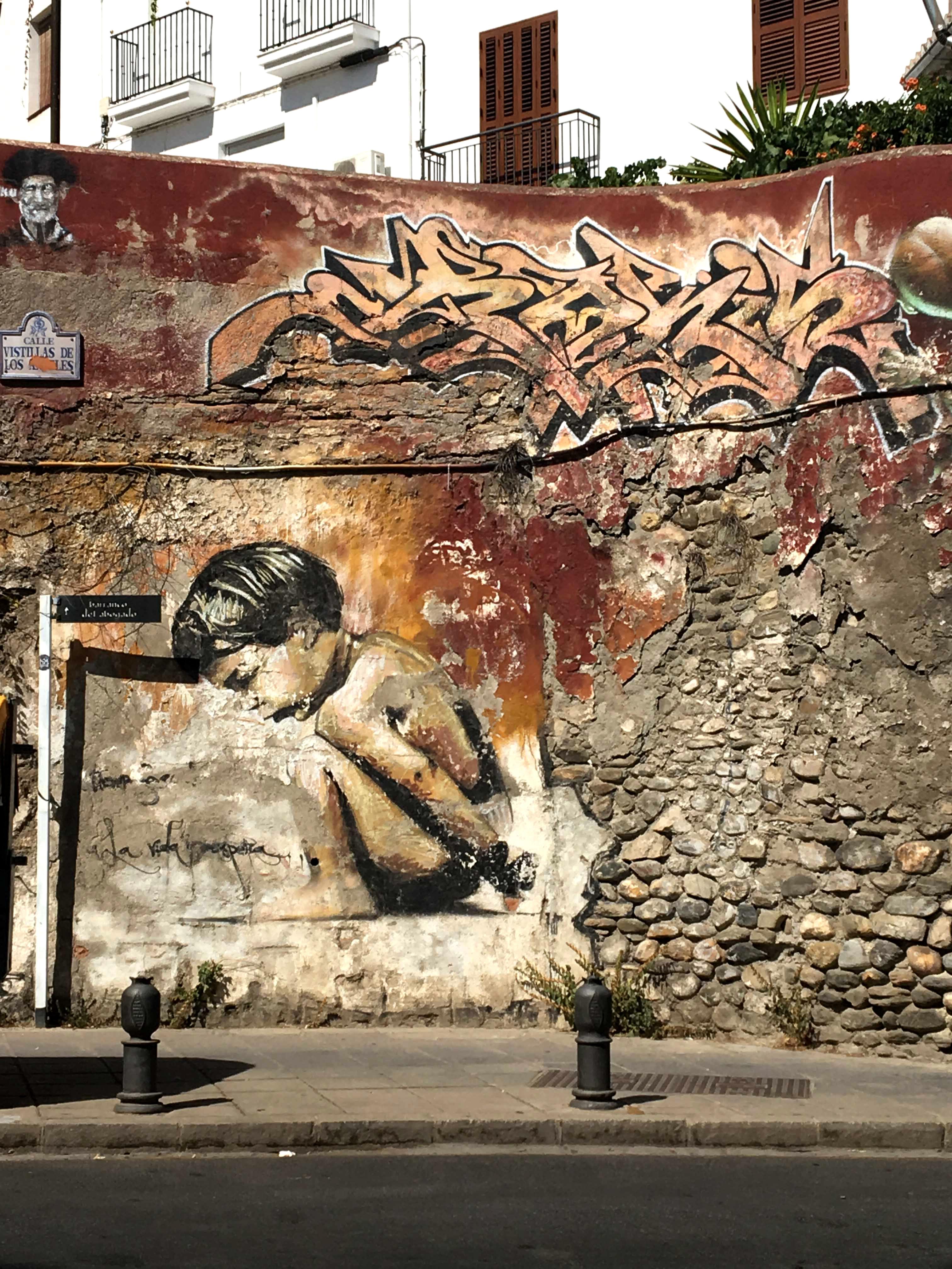 Mural von El Niño de las Pinturas zeigt ein hockendes Kind